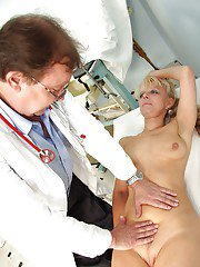 Blonde Mature bends over for some Asshole stuffing at the Gyno office