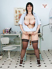 Naughty mature Nurse in stockings shoving toys into her throbbing twat