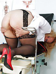Chubby mature nurse in uniform showing and toying her hairy cunt