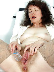 Busty mature nurse spreading her legs and playing with a gyno tool
