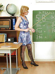 Horny mature teacher in glasses fingering and toying her gloryhole