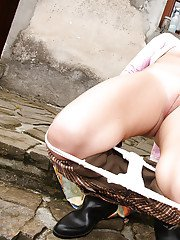Lusty babe in boots Cora masturbating her muff with a toy outdoor