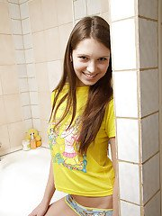 Sweet teen babe Amber B taking bath and playing with herself