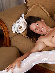 Slutty mature woman in stockings stripping and spreading her legs