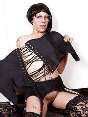 Brunette MILF in lacy stockings showing off her unshaven pussy