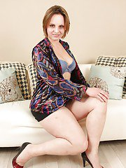 Chubby MILF on high heels stripping and spreading her legs