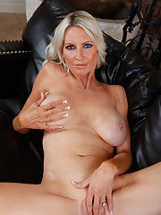 Seductive mature lady Emma Starr stripping and spreading her legs