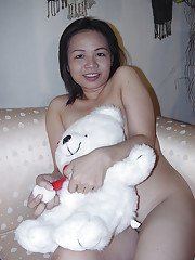 Chubby asian cutie taking off her clothes and posing naked on the sofa
