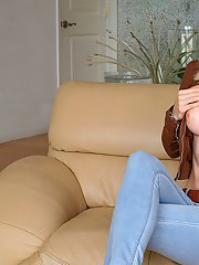 Blonde babe Margo Russo uncovering her big tits and taking off her jeans