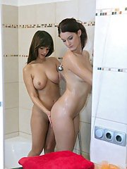 Smoking hot european babes with big tits taking shower together