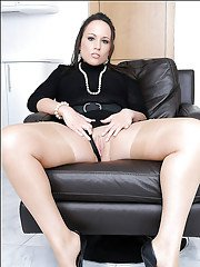 Gorgeous MILF in nylon stockings stripping off her dress and lingerie