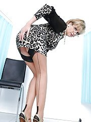 Hot mature lady in glasses doing upskirt and stripping off her dress