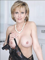 Stunning mature lady with amazing round tits taking off her bra