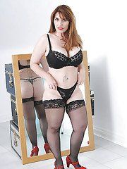 Fatty mature babe in stockings exposing her giant boobs and big ass
