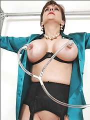 Gorgeous mature lady in stockings gets handcuffed and breast-pumped