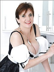 Gorgeous mature babe with fuckable ass posing in maid uniform