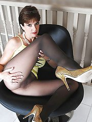 Lusty mature lady with shaved pussy posing in sheer pantyhose