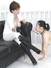 Kinky mature lady in black boots having lesbian fun with her asian friend