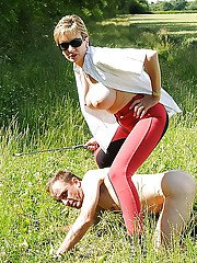 Lusty mature lady in sunglasses tortures her manslave outdoor