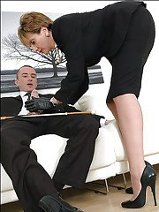 Fully clothed mature lady in leather gloves gives a handjob