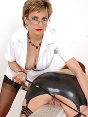 Seductive mature lady in glasses spanking her friends hot ass