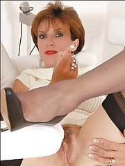 Hot mature babe in stockings spreading her legs and teasing her hairy cunt