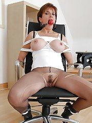Busty mature babe in ripped pantyhose posing bound and ballgagged