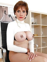 Stunning mature lady showing off her big tits with pinched nipples