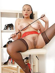 Fetish MILF with big jugs and trimmed pussy posing in nylon stockings