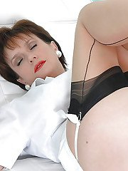 Horny mature lady in nylon stockings gets fucked by a machine