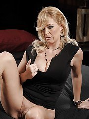 Sexy MILF on high heels Charlee Chase showing off her pussy and big tits