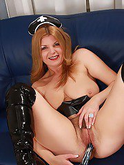 Busty mature babe in latex boots masturbating her hairy twat with a toy