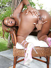 Curvy ebony babe Angel Eyes stripping and spreading her legs outdoor