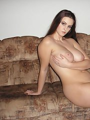 Curvaceous babe stripping off her clothes and showing off her big tits