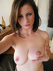 Busty babe stripping off her lingerie and exposing her shaved pussy