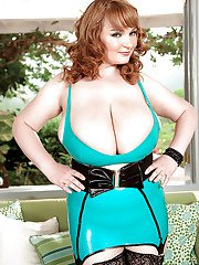 Buxom mature babe in latex outfit Micky Bells showing off her giant jugs