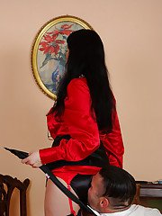 Mature femdom in stockings enjoys ass licking and tortures her manslave