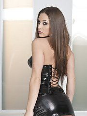 Smoking hot babe Gracie Glam posing in latex outfit and boots