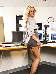 Blonde MILF in glasses Jessica Drake uncovering her sexy body in the office