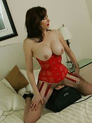 Adorable amateur babe in stockings and lingerie tortures an older woman