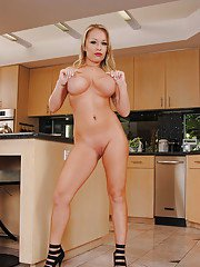 Blonde MILF on high heels Jessica Moore stripping off her dress and panties