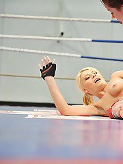 Angel Rivas  Niky Gold catfighting and kissing each other in a ring