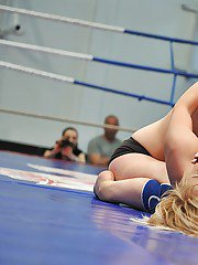 Well toned lesbians punching and caressing each other in the ring