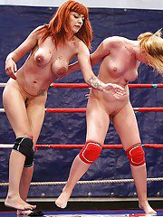 Foxy lesbian Mai Bailey loses a catfight and licks winners pussy