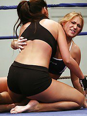Rough catfight of two sporty MILFs ends up with lesbian sex