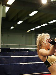 Pretty lesbians gasping and stripping each other in the wrestling ring