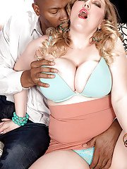 Buxom MILF Sabina Leigh is into interracial sex with a black guy
