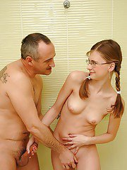 Teen cutie in glasses gets fucked by an older guy in the shower