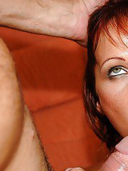 Redhead mature babe gives a deepthroat blowjob and gets fucked