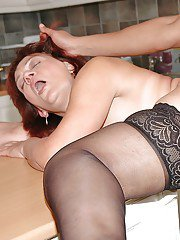 Mature babe in stockings seduces a young guy for interracial sex
